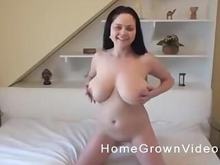 Brunette with big tits gives a POV titjob alongside the bathtub