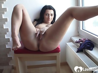 Darkhaired Babe fingers her bedraggled hoochie-coochie on camera
