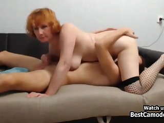 Horny Redhead Cougar Fucks Young Man On Couch