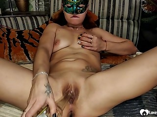Tempting stepmom masturbates with a bottle before making love