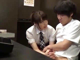 Seductive young Asian office non-specific uses her hands and mouth to issue pleasure