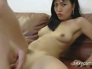 Hairy Asian chick gets her bootie hole and slit screwed hard