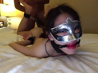 Young Chinese beauty in fetish mask nailed by White Sponger
